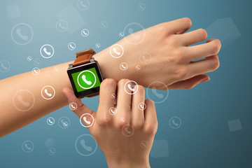 Hand with smartwatch and call icon around