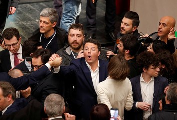 Italy's ruling centre-left Democratic Party (PD) leader Matteo Renzi reacts during an electoral rally in Rome