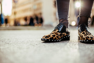 Girl in leopard print flat shoes.