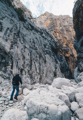 Aged Man hiking insdide the deepest canyon in Europe - Activity and Health concept - Gola Su Gorroppu