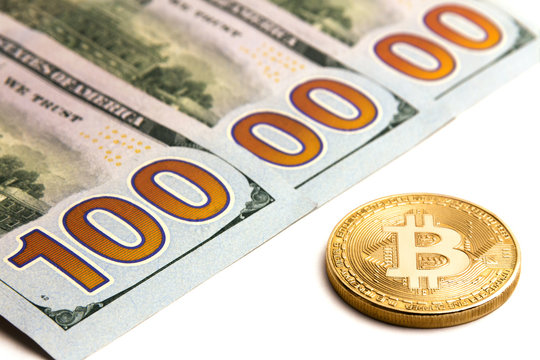 What cryptocurrency exchange rate. Gold bitcoin next to US banknotes. Three hundred dollar bills. One million dolars. White background.
