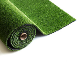 artificial rolled green grass isolated on white background