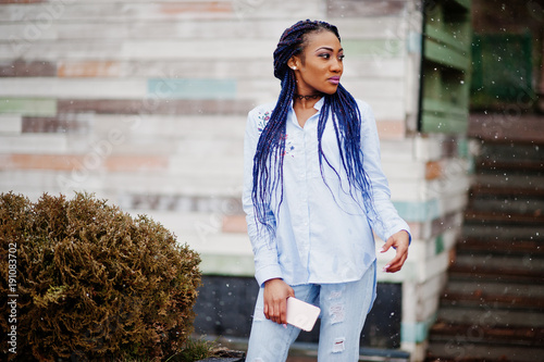 Stylish African American Girl With Dreads Holding Mobile Phone At