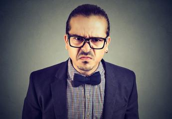 Gloomy man posing expressively