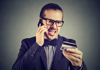 Screaming man solving problems with credit card