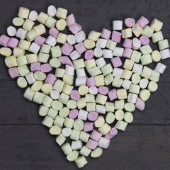 marshmallow for Valentine Day in heart shape on wood