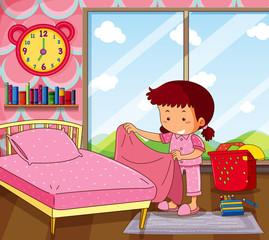 Girl making bed in pink bedroom