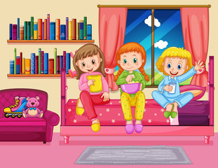 Three girls eating snack in bedroom