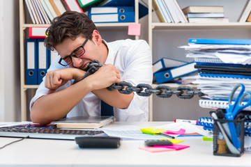Employee attached and chained to his desk with chain
