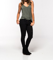Attractive Woman in a Tank Top and Black Jeans - Full Length