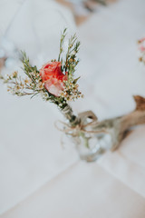 Simple elegant bridal posy with a fresh pink rose