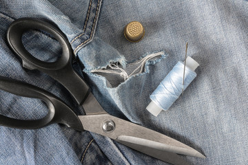 Jeans pants with hole for sewing knives and threads