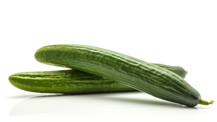 Two European cucumbers (burpless, seedless, hothouse, gourmet, greenhouse or English cucumber) isolated on white background.
