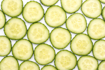 European cucumber slices background top view (burpless, seedless, hothouse, gourmet, greenhouse, English) isolated on white.