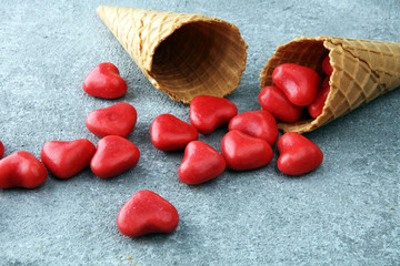 Valentine day candy with red hearts and cones