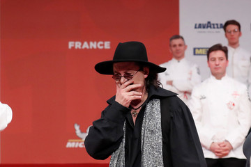 French chef Marc Veyrat reacts after he was awarded with three Michelin stars for his restaurant La Maison des Bois in Manigod, at the Seine Musicale center in Boulogne-Billancourt near Paris