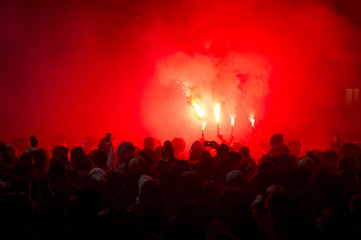 football fans lit up the lights and smoke bombs. revolution. protest