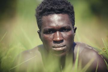 Close-up portrait of confident farmer on field