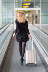 Blond woman running to the gate at the airport
