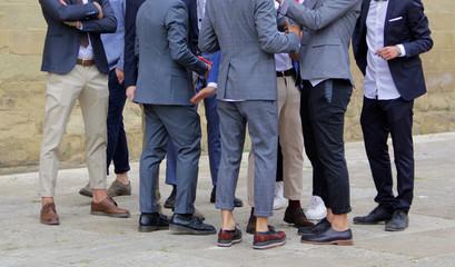 Fashionable young men at an Italian wedding.