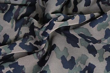 Military fabric closeup pattern texture as background. Macro photo.