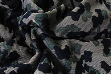 Military fabric closeup pattern texture as background. Macro photo.