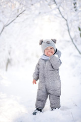 child in the forest in the snow