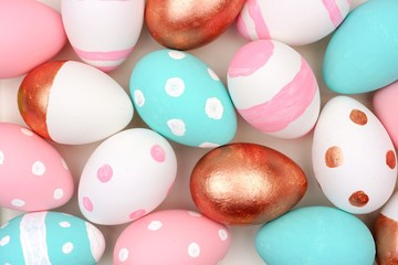 Easter egg background. Painted, pink, turquoise, rose gold and white colors.