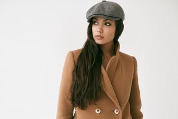 Beautiful glamor brunette woman wearing coat