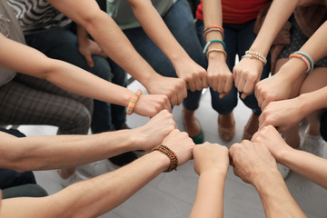 People putting hands together as symbol of unity