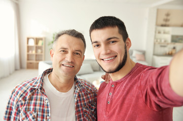 Young man and his dad at home