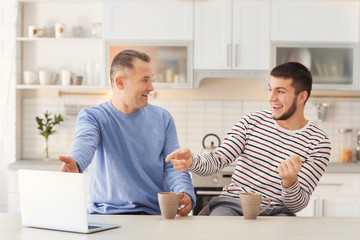 Mature man spending time with his son at home