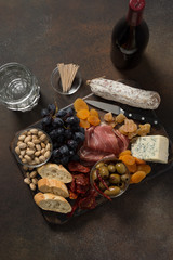 Charcauterie for Two Served on Wooden Board Accompanied with Wine