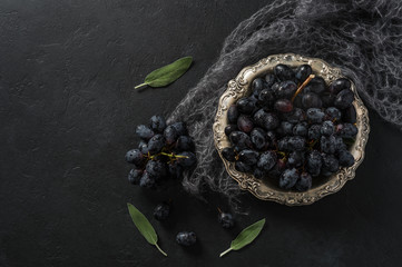 Black Concorde Grapes Are Served in an Antique Silver Bowl