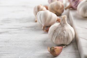 Fresh garlic on wooden table