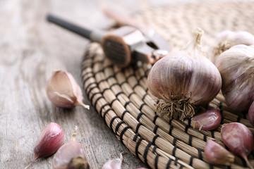 Fresh garlic on wicker mat, closeup