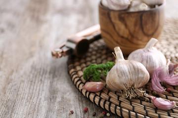Fresh garlic on wicker mat