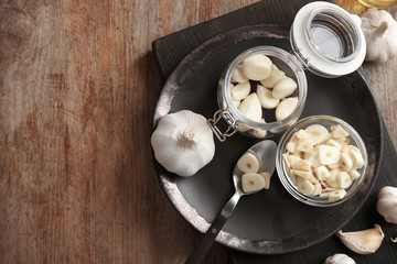 Kitchenware and garlic on wooden table