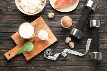 High protein food and different powders on table