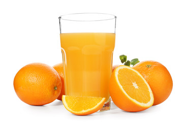 Glass of fresh orange juice with fruit on white background