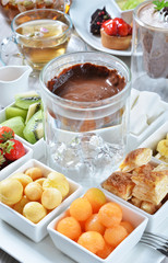 Chocolate fondue with various kind of fruit.