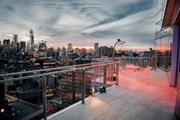 Luxury city rooftop balcony with chilling area in New York City Manhattan midtown. Elite real estate concept.