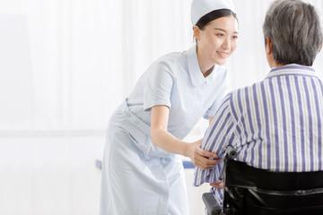 Nurses care for sick older people