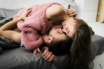 Sensual romantic foreplay by couple in love in bed. Arrwork.