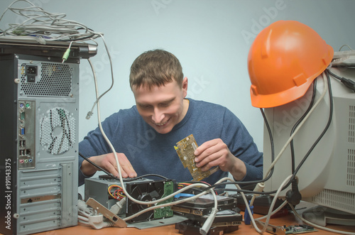 Happy Computer technician engineer holding in hands a video