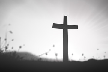 Good friday concept: Black and white cross over blurred nature background