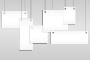 Templates of posters or empty hanging photo frames isolated on a gray background. A set of empty hanging photo frames.