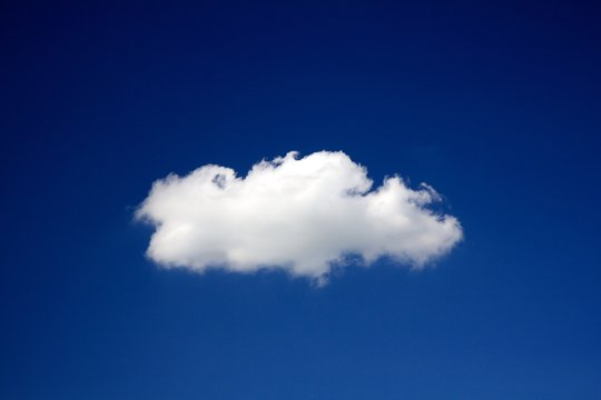 Lonely cloud on a clear deep blue sky