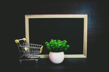 small trolley  and Empty blackboard for copy space area