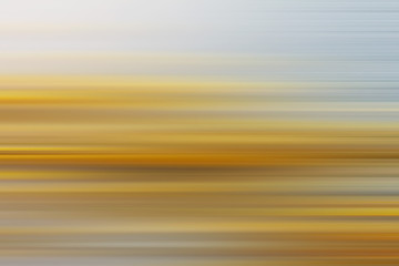 abstract blurred background with horizontal grey and yellow stripes